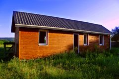 Wooden house in countryside. Royalty Free Stock Images