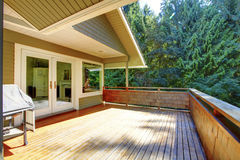Wooden house deck with nice summer greenery view. Simple large wooden deck with nice greenbelt scenery stock images