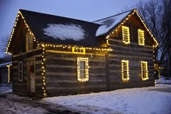 Wooden house decorated with Christmas lights. Wooden house decorated with Christmas white lights royalty free stock images