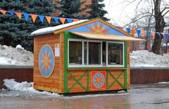 A wooden house decorated by suns - Shrovetide symbols. MOSCOW, RUSSIA - MARCH 16: A wooden house decorated by suns - Shrovetide symbols. This is a souvenirs and Stock Photo