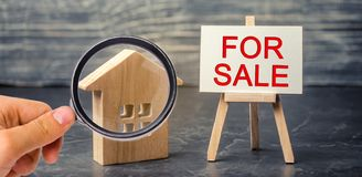 Wooden house and dollars with the inscription `for sale`. sale of property, home. affordable housing. sale of apartments. real est. Ate agent services. realtor stock photos