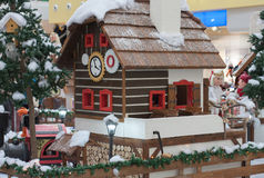 Wooden house with elfs and angels in shopping center. Wooden house with elfs and angels as christmas decoration  in shopping center Royalty Free Stock Images