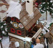 Wooden house with elfs and angels in shopping center. BRNO,CZECH REPUBLIC-NOVEMBER 19,2016: Family watching wooden house with elfs in shopping center Olympia on Stock Photography
