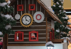 Wooden house with elfs and angels in shopping center Royalty Free Stock Photos