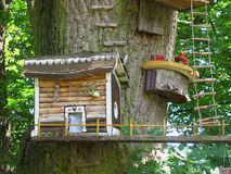 Wooden house of elves. A wooden house mounted on a deciduous tree. Weekend cottage for elves stock photography