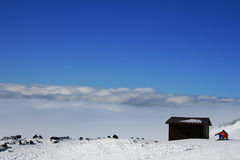 Wooden house on Etna Volcan covered by snow Royalty Free Stock Photo
