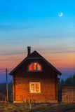 Wooden house exterior with lights Stock Photography
