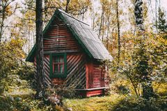 Wooden house in fall forest Royalty Free Stock Image
