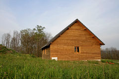 Wooden house in field Royalty Free Stock Image