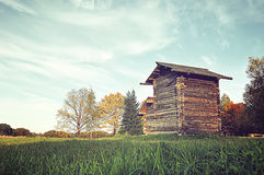 Wooden house in the field - autumn rural landscape Stock Images