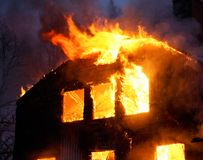 Wooden house in flames. Wooden house buring Royalty Free Stock Photos