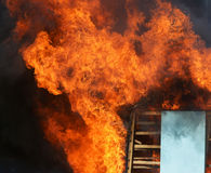 A Wooden house in flames Royalty Free Stock Photos