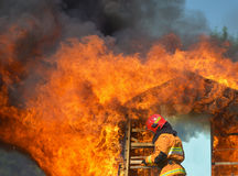 A Wooden house in flames Stock Image