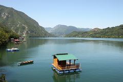 Wooden house floating on Drina river. Landscape royalty free stock image