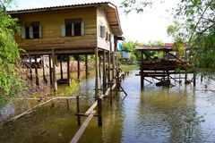 Wooden house flooded, old rural house in water.  royalty free stock images