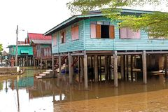 Wooden house flooded, old rural house in water.  stock photography