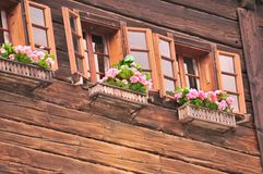 Wooden House with flowers in Hallstatt Royalty Free Stock Photos