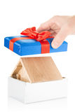 Wooden house in a gift box Stock Images