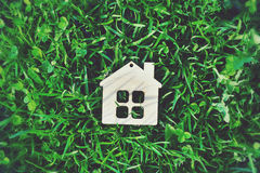Wooden house in grass Stock Photo