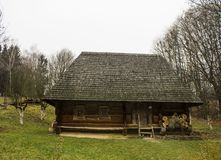 Wooden house on the grass. Wooden house and green grass, Shevchenko Park, Lviv, Ukraine Royalty Free Stock Photos