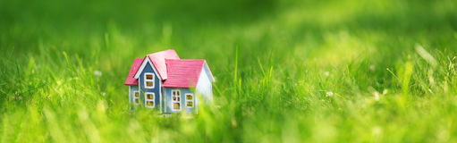 Wooden house on the grass Royalty Free Stock Photo