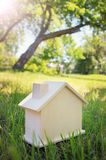 Wooden house on the grass Royalty Free Stock Image