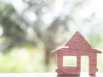 Wooden house on a green blur bokeh background. Love nest, relationships. Buying a house . Affordable housing. concept idea.  royalty free stock image