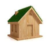 Wooden house with a green grass on a roof. Royalty Free Stock Images