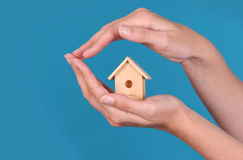 Wooden house on the hand Royalty Free Stock Image
