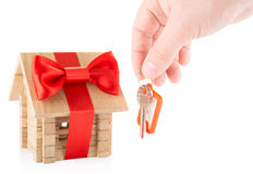 Wooden house and hand with keys royalty free stock images