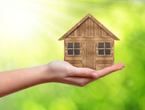 Wooden house in hand Royalty Free Stock Photo