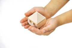 Wooden house in the hand Royalty Free Stock Photo