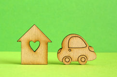 Wooden house with hole in the form of heart with car icon on gre Stock Images