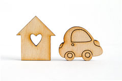 Wooden house with hole in the form of heart with car icon on whi Stock Image