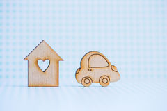 Wooden house with hole in form of heart with wooden car icon on Stock Images