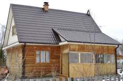 The wooden house in a housing estate. Stock Photography