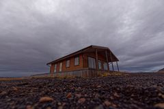 Wooden house in Iceland. A highly insulated wooden house in Iceland  built on a raised platform surrounded by pebbles suggesting proximity to the sea shore Royalty Free Stock Photos