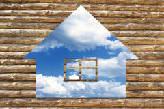 Wooden house icon on blue sky background Stock Photo