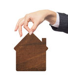 Wooden house icon in woman hand isolated on white background Royalty Free Stock Image