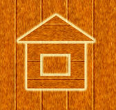 Wooden house icon. On wood background Stock Image