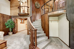 Wooden house interior with circular staircase and carpet floor. Northwest, USA Stock Photography