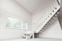 Wooden house interior with stairway Royalty Free Stock Photography