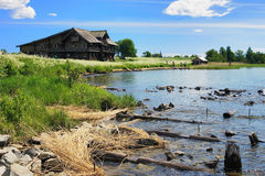 Wooden house on island Kizhi at the shore of lake Stock Images