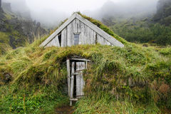 Wooden house isolated with grass in Iceland Stock Photography