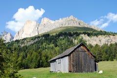 Wooden house in italian mountain landscape. Wooden house in mountain landscape Royalty Free Stock Image