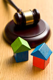 Wooden house and judge gavel Royalty Free Stock Photos