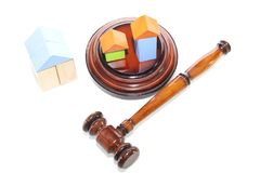 Wooden house and judge gavel on a white background. Is royalty free stock photography
