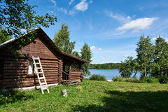 Wooden house on lake Stock Image