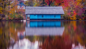 Wooden house on the lake in autumn season stock photo