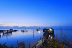 Wooden house on lake Royalty Free Stock Photography